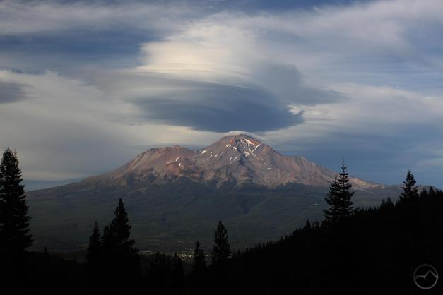 Mount Shasta City visible below clouds and mountain.