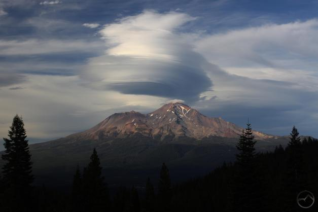 The clouds begin to expand over Mount Shasta.