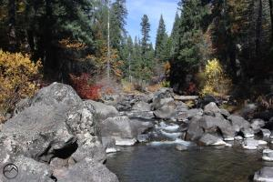 Large boulders dot a section of the McCloud River