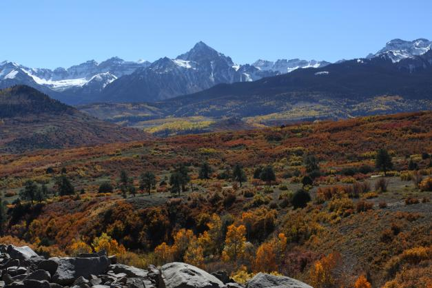 Incredible fall color highlights the view of Mount Sneffels.