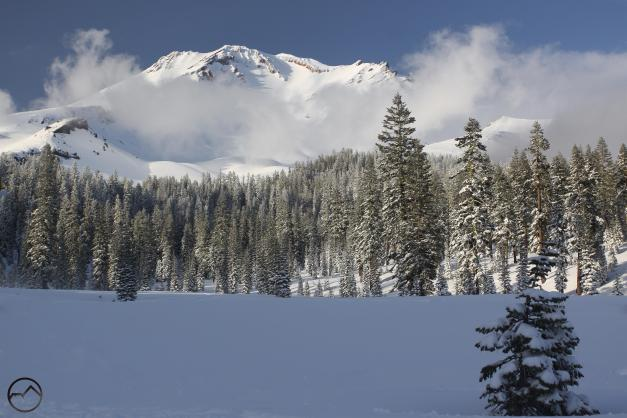 Mount Shasta, blanketed in fresh snow, rises above Bunny Flat